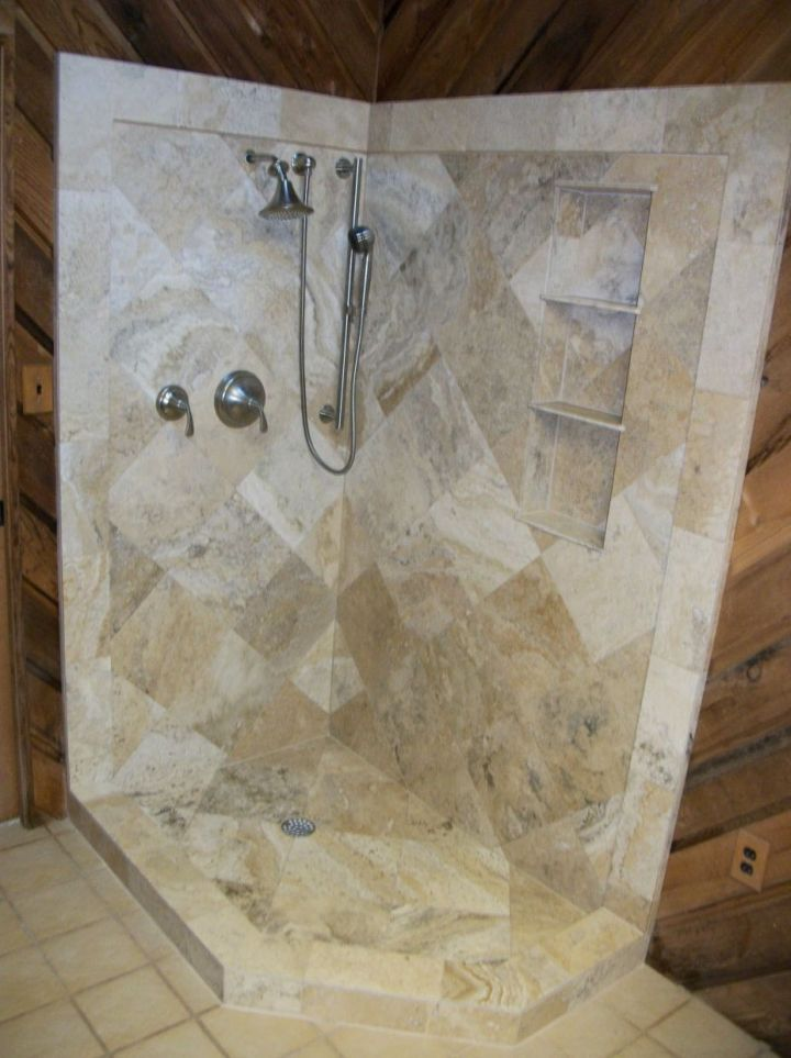 diagonal travertine tile shower with wide border