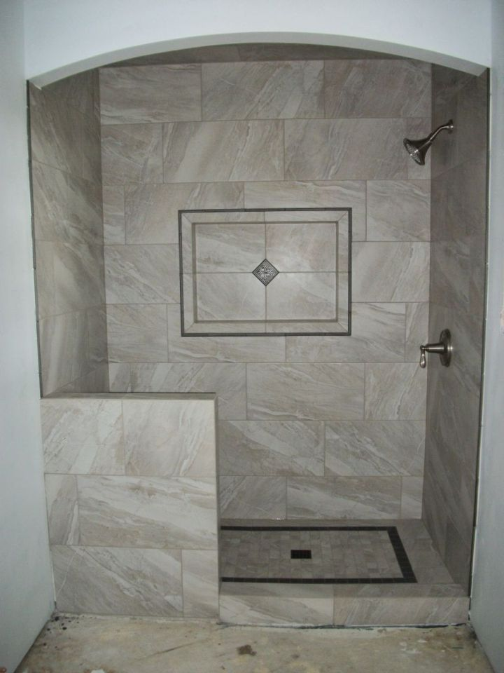 gray rectangle tile shower with arch top and half wall