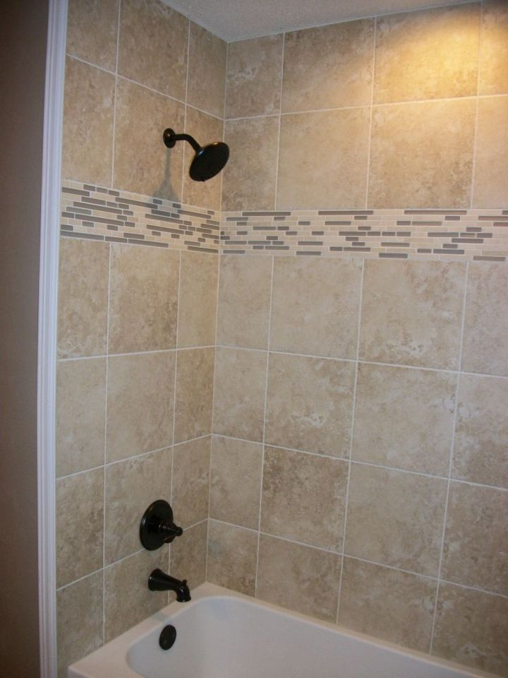 Tile Tub Surround With Linear Mosaic And Bronze Plumbing Fixtures