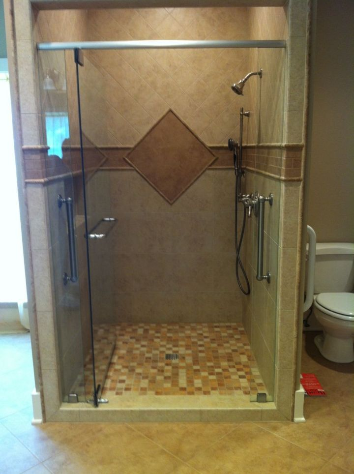 tile shower with a single diamond accent