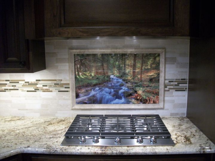 Painted ceramic tile mural over cooktop on kitchen backsplash