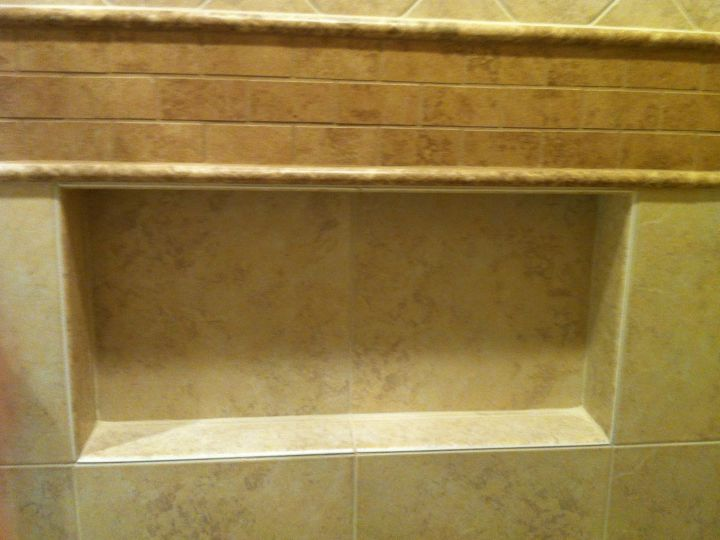 Recessed tile soap niche below accent band.