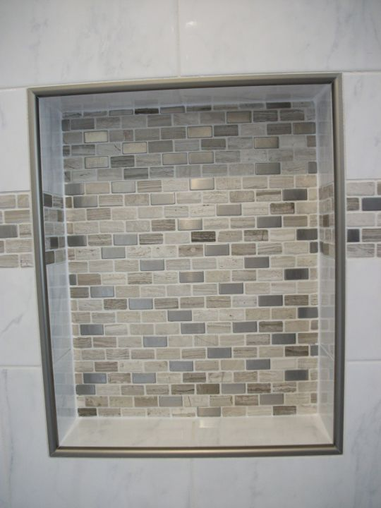 Recessed tile niche with mosaic back wall
