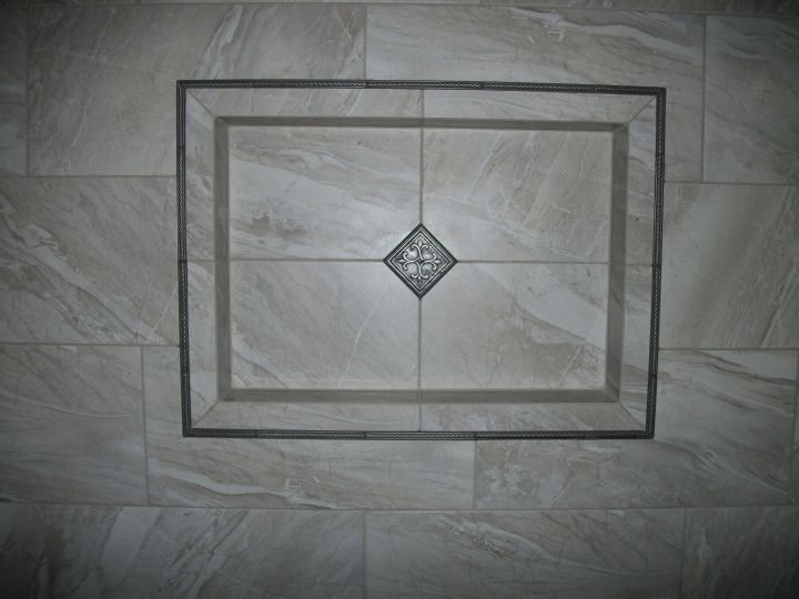 Framed recessed tile niche with double border