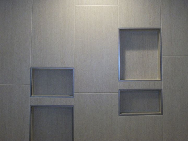 Four recessed tile shelves that matches tile sizes