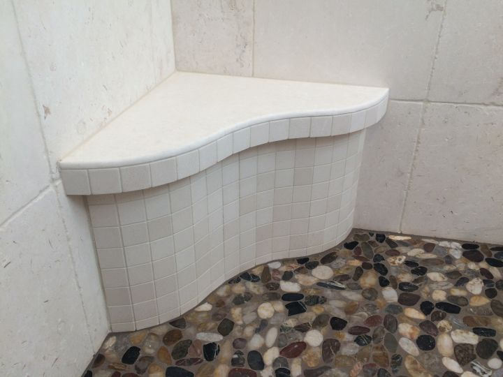 Arched tile seat with mosaic tile on face