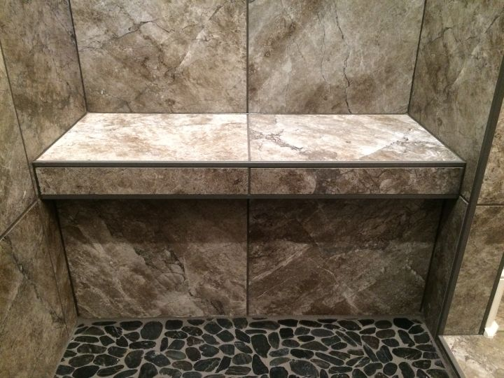 Tile bench between walls with edge profile on ledge