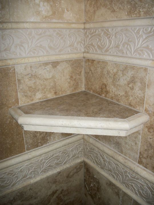 Tile shelf with ogee edge between two decorative bands