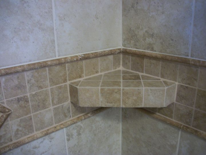 Corner shelf of mosaic tile