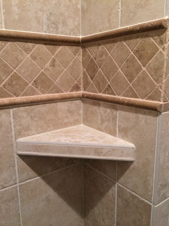 Corner tile shelf with bullnose edge