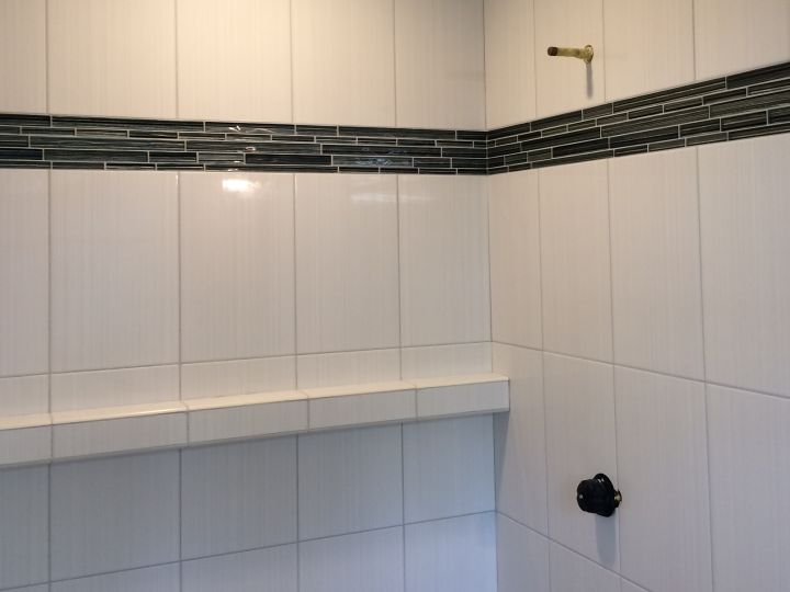 Tile shelf along full wall of shower