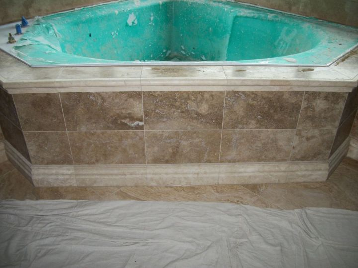 Travertine Tile On Garden Corner Tub With Ogee Edge And Base On Tub Front  Panel