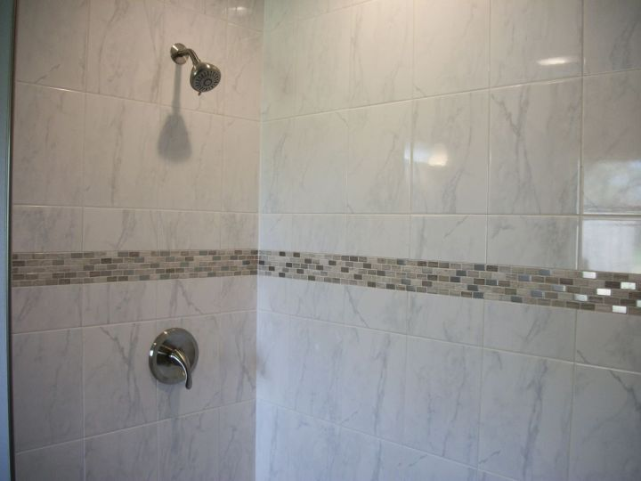 Carrara White Ceramic Tile Shower With Nickel Valve Trim And Metal Accent Band